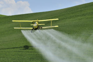 crop-dusting-pesticide-roundup-field-plane-featured